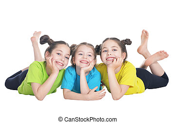 portrait of cute little girls posing isolated on white...