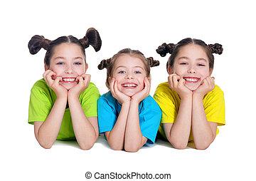 portrait of cute little girls posing in studio