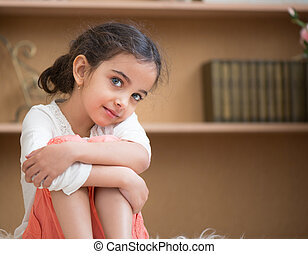 Portrait of cute little hispanic girl
