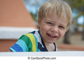 Portrait of cute little smiling boy