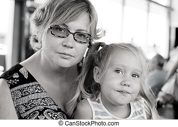 Portrait of cute mother and daughter
