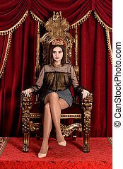 Portrait of cute queen sitting on throne