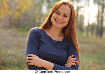 portrait of cute red haired young woman