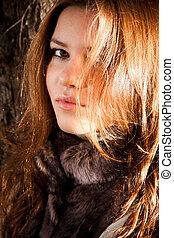 Portrait of cute redhead girl posing in sun light - Closeup...
