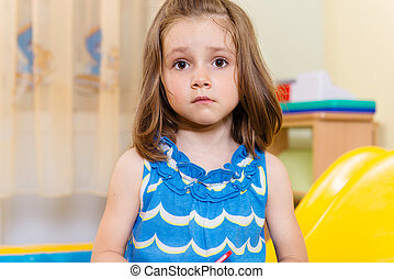 Portrait of cute serious little girl