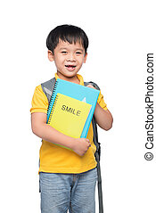 Portrait of cute smiling boy with backpack and colorful books, education and back to school concept