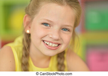 Portrait of cute smiling girl with plaits - Close up ...