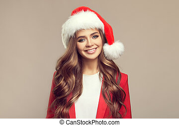 Portrait of cute smiling woman in santa hat. Christmas.
