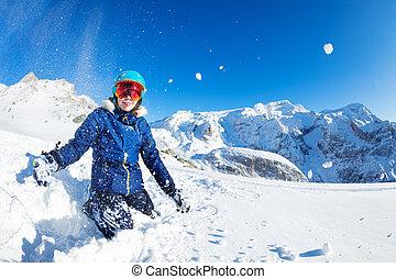 Portrait of cute teen girl throw snow in the air