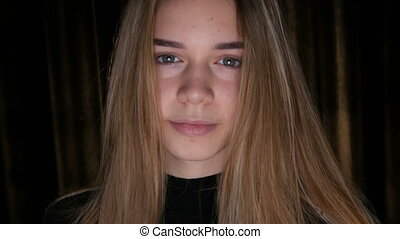 Portrait of cute teen girl with long white hair and green eyes poses for the camera in studio. Teenage Skin and Acne Problems