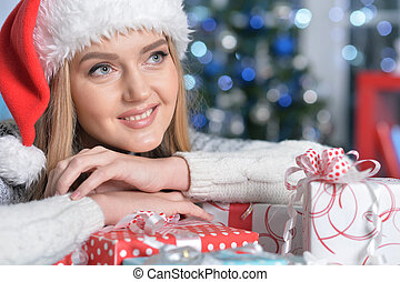 Portrait of cute woman with present boxes