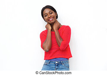 cute young black woman smiling against white background
