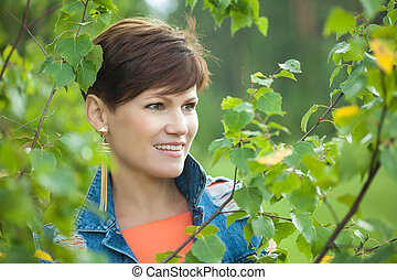 Portrait of cute young brunette posing outdoor