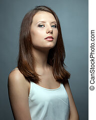 Portrait of cute young brunette with healthy skin
