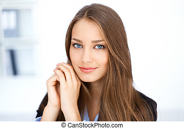 portrait of cute young business woman in office