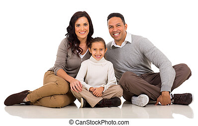 young family sitting on white