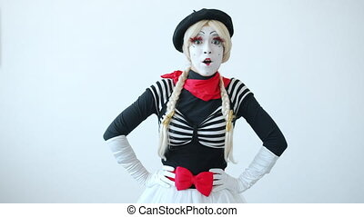 Portrait of cute young lady mime waving hand and smiling sending air kiss and flirting looking at camera on white background. People and greetings concept.