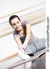 portrait of cute young woman exercising