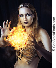 dangerous woman witch with fire ball - Portrait of dangerous...