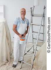 Portrait Of Decorator Painting Room