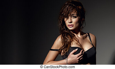 Portrait of delicate brunette beauty posing