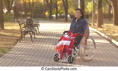 Disabled elderly woman sit on wheelchair alone