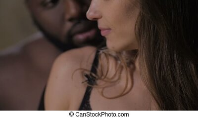 Portrait of diverse couple in love during foreplay - Closeup...