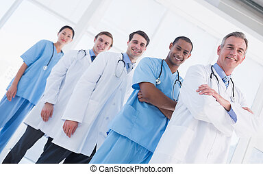 Portrait of doctors standing in a row at hospital