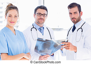 Portrait of doctors with x-ray report