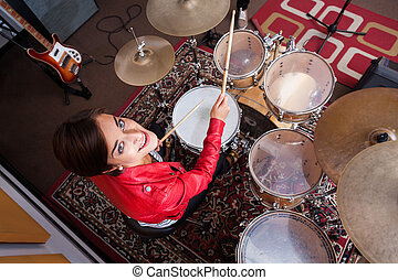 Portrait Of Drummer Performing In Recording Studio