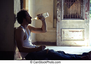Portrait of drunk male alcoholist drinking whiskey - People,...