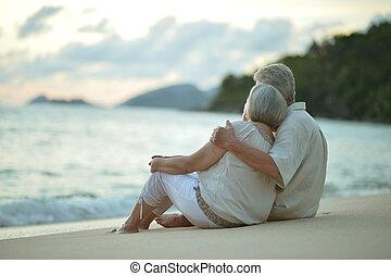 Portrait of elderly couple on a beach