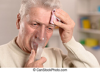 man with flu inhalation