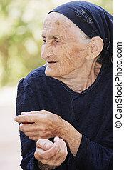 Portrait of elderly woman looking sideways