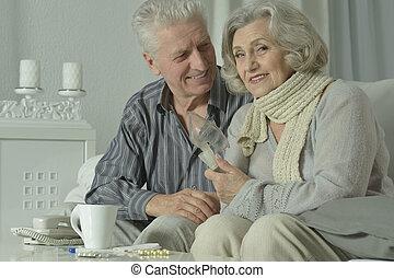 elderly woman with flu inhalation
