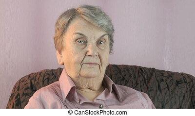 Portrait of elderly woman with harsh look - Elderly woman...