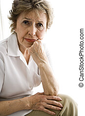 Portrait of elderly woman with serious expression