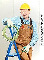 Portrait of Electrician with wire equipment