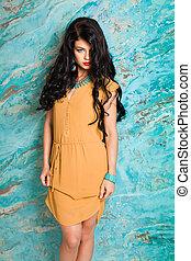 Portrait of elegant beautiful woman in yellow dress