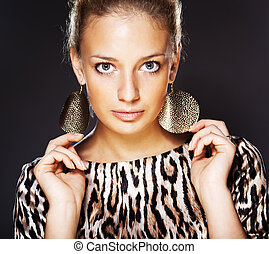 Portrait of elegant beautiful woman wearing jewelry.