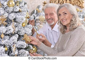 couple near christmas tree