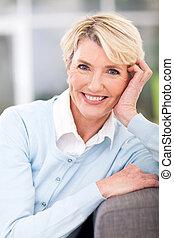 elegant elderly woman sitting at home