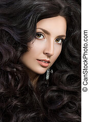 Portrait of elegant woman with beautiful black hair