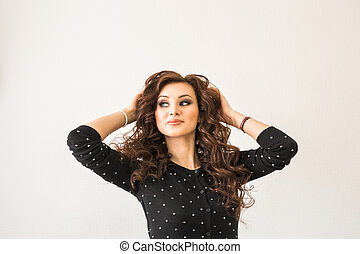 Portrait of elegant woman with curly hair