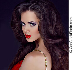 Portrait of elegant woman with red lips and long curly hair styling