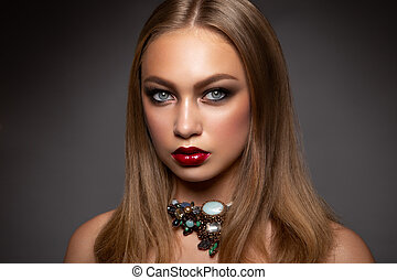 Portrait of elegant woman with red lips