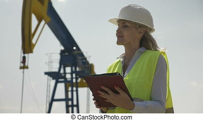 Portrait of engineering female coordinator supervising...
