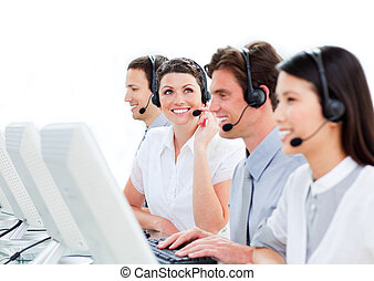 Portrait of enthusiastic customer service agents working in a call center against a white background