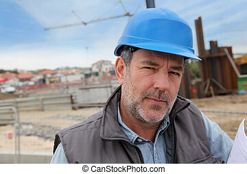 Portrait of entrepreneur on building site