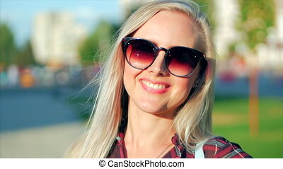 Portrait of European Cute Blonde in with Sunglass Young Happy Woman or Cheerful Girl Looking in The Camera, Blowing Wind Hair the Wind , Slow Motion.